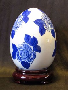 "White Porcelain / Ceramic Egg Painted Blue Flowers Wood Base / Stand 5.5"" Tall"