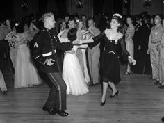 G.I.'s dancing with the USO hostesses at the dance. LIFE, 1942