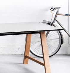 Classic craftsmanship that stands in sharp contrast to the sharp lines of the tabletop.