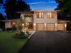 Garage doors can make up a large portion of your home's exterior design, and if facing the street, they may be the first thing visitors see. Here are some tips on how your doors can enhance your home's style. Photo courtesy of Clopay