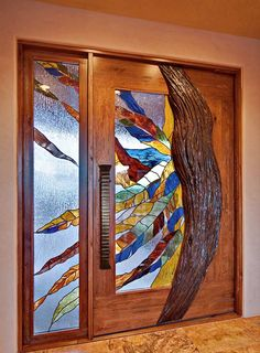 I'm an equal opportunity door lover.  Arts and Crafts.  Craftsman.  Art Deco.  Art Nouveau.  Castle.  Cabin.  Love them all.  And THIS is a totally freakin cool door... with the exception of the hardware...