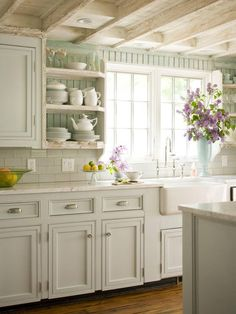 Sink, window over sink, open shelves