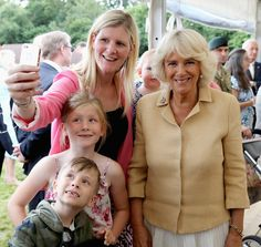 Camilla, Duchess of Cornwall has her picture taken with family of members of the armed forces as she visits the Poppy Pod Village at the Tile Barn Outdoor Centre on July 26, 2016 in Brokenhurst, England. The Village stands on the site of a former First Word War Hospital and provides accomodation for sevice personnel and their families.