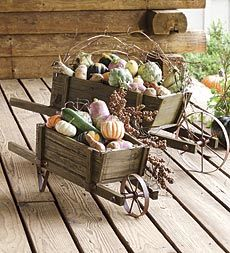 decorative-solid-wood-wheelbarrow-planters-with-functional-wheels