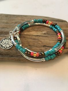 This vibrant Bohemian Style Bracelet/Necklace will be noticed and adored! Beautiful colors of turquoise, Copper, golden yellow and coral! There are silver tube beads throughout and silver Tibetan beads. Its made to wrap around your wrist three times and connects with a lobster