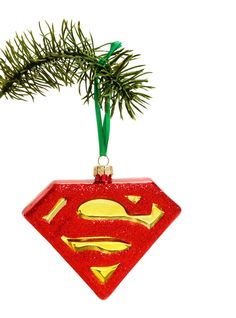"""A red glittery """"S"""" stands for a few things, and now """"seasonal bling"""" is one of them. A blown glass <i>Superman</i> ornament brings DC Comics to any Earth holiday.<div><br></div><div><ul><li style=""""list-style-position: inside !important; list-style-type: disc !important"""">3 1/2"""" x 4""""</li><li style=""""list-style-position: inside !important; list-style-type: disc !impo..."""