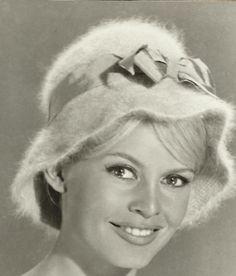 Brigitte Bardot modelling hats by Jean Barthet