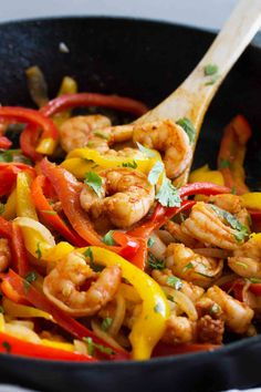 Dinner in a jiffy - these Skillet Shrimp Fajitas are not only healthy, but can be done in under 30 minutes! Peppers, onions and shrimp make an easy dinner.