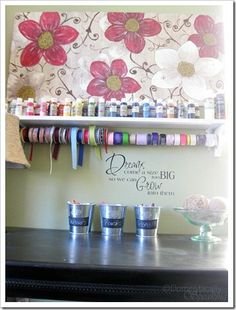 Update a basic shelf with a dowel to create a great organization space for your acrylic paint and ribbons.
