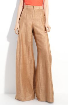 mmhm 70s inspired high waisted wide leg flowing pants... imagine a simple white tube top, tucked in with stacked heels. A floppy hat or long tousled curls to complete the look.