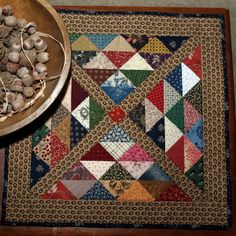 """""""Triangles in the X"""" (posted by PetitQuilts to Etsy)"""