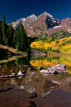 Maroon Bells reflecting in Maroon Lake near Aspen, Colorado.