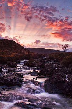 Fireworks looking Sunset at waterfall Sligachan, Isle of Skye, Scotland.