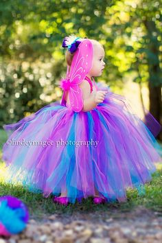 This little munchkin looks like she could take off and fly right down Sesame Street in her fancy schmancy Abby Cadabby Costume.