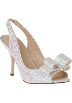 KATE SPADE Charm Heel Ivory Glitter $295  (Compare Elsewhere $330) SHIPS FREE BEST PRICES YOU WILL FIND ANYWHERE ON GENUINE LADIES DESIGNER BRANDS! FREE WORLD SHIPPING & LOCAL DELIVERY AVAILABLE AT THE SURF CITY SHOP in Huntington Beach, California Major Credit Cards Accepted