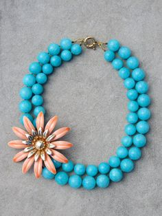 turquoise with coral flower