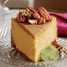 Pumpkin-Pecan Cheesecake | Test Kitchen Professional Pam Lolley combined the flavors of three favorites—pumpkin pie, pecan pie, and cheesecake—to create this luscious fall dessert. | SouthernLiving.com