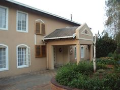 Still Waters Guest House - Still Waters Guest House offers upmarket accommodation to business executives or leisure travellers and lies nestled in the leafy suburb of Douglasdale, Sandton.  Adorned with dark wood and modern furniture, ... #weekendgetaways #johannesburg #southafrica