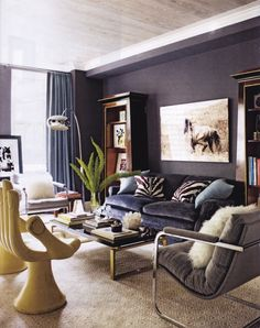 I would never think of painting the wall the same color of a bold couch but I love this Livingroom