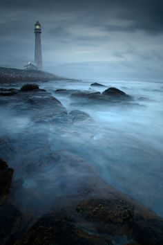 Interesting places to visit in South Africa. Slangkop Lighthouse is near the town of Kommetjie, near Cape Town, South Africa. Lighthouse Pictures, Lighthouse Keeper, Stormy Sea, Beacon Of Light, Kirchen, Windmill, Strand, South Africa, Westerns