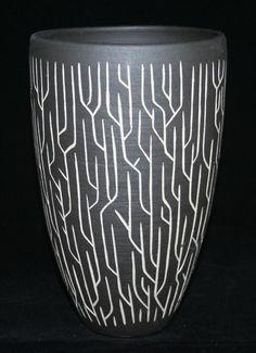 White stoneware vase with incised black slip. Sgraffito
