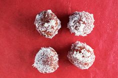 This version of South African koeksisters, which originated in Cape Malay, are donut holes soaked in a spiced syrup, then rolled in coconut flakes.