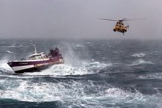 A Royal Air Force search and rescue Sea King helicopter comes to the aid of the French Fishing vessel Alf (LS683637) during a storm in Irish Sea.