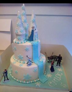 Frozen castle cake w/ towers on top tier