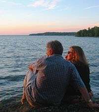 A couple reconnect at sunset while kids enjoy award winning evening children's programs at Tyler Place Family Resort in Vermont, US.