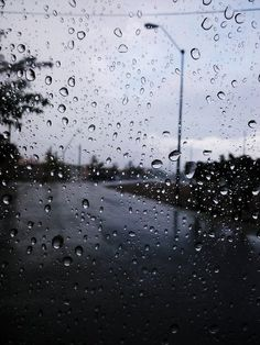 When I was a kid, my bed was right by my window, and I would spend hours and hours sitting on my bed just gazing out, watching the rain fall and trickle down the screen.