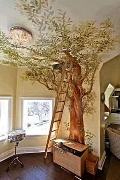 Amazing tree painted on the wall leading to the attic. Awesome detail. Makes for a very earthy and cozy feel.