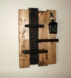 Reclaimed Rustic Distressed Wood Wall Shelf With Rustic Tea-light Lantern Rustic Wood Shelf Width- 14 Height- 21 **Rustic Lantern is included** This distressed/ primitive wood shelf has been sanded, painted and stained displaying Teal and Oak colors. We can do custom sizes upon