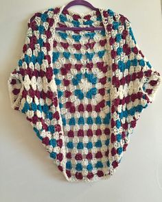 A personal favorite from my Etsy shop https://www.etsy.com/listing/289759153/granny-square-cocoon-cardigan