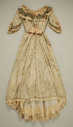 Dress Designer: Jeanne Hallée  Date: 1880s Culture: French Medium: silk, metallic Accession Number: C.I.50.40.10a, b