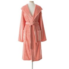 Get wrapped up in this silky-smooth fleece hooded robe in a cool coral hue. Made with a special knitting and polishing technique and featuring a roomy hood, its the perfect indulgence for any time of day.   • 100% polyester.
