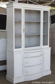 I need to find a cabinet like this on Craigslist, paint it, and add chicken wire for my office.  Love.