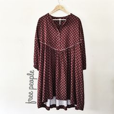 Free People Boho Print Robe Dress Half button with small fringe detail print boho dress. New without tags! Size large and fits oversized. Can probably fit an XL too because it really is roomy and oversized. I'm a medium for reference. Will better fit someone who is taller than me and who is a large. I'm 5'3 1/2 and is 137lbs  super boho long sleeve dress  Free People Dresses Long Sleeve