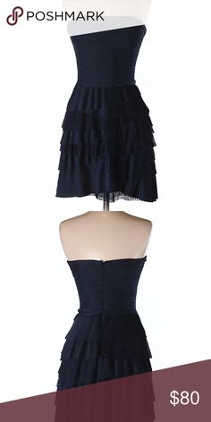 BCBGMaxazria Cocktail Dress Navy Blue NWT Size 4 BCBGMaxazria navy blue dress. NWT. Fit and flare silhouette, 100% polyester.  Size 4. Zipper on the back. No low ball offers, this is a brand new designer dress. Same/next day shipping on all orders! BCBGMaxAzria Dresses Strapless