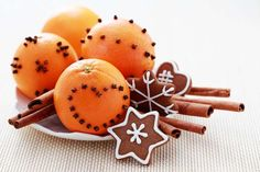 oranges with cloves and cookies I remember making clove-studded oranges at Christmas when I was quite young