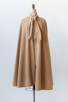 I want to wear this cape with an impossibly colorful hat and star in a Wes Anderson movie. #gorgeous #cape #vintage vintage 1970s camel wool knot cape