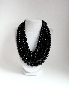 Hey, I found this really awesome Etsy listing at https://www.etsy.com/listing/259868244/chunky-black-pearl-necklace-multi-strand