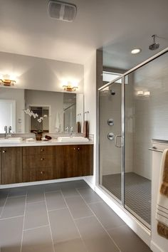 Contemporary 3/4 Bathroom with Flush, flush light, Specialty Tile, Limestone tile counters, European Cabinets, Double sink