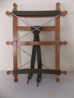 A wooden back pack frame. Includes rope and woven cotton straps attached to frame. from EBTH.com