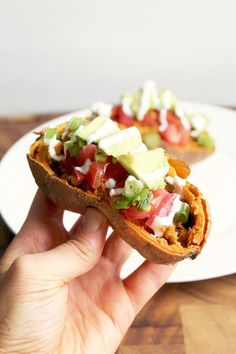 Baked Sweet Potato Tacos -- A healthy dinner recipe that uses sweet potato skins as the taco shell! High in fiber, protein, and vegan-friendly! | @sinfulnutrition www.sinfulnutrition.com