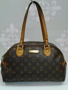 """Authentic Louis Vuitton Montorgueil PM Handbag $318.99 LOUIS VUITTON Number MI0089 Pocket - Interior Slide Pocket. Measurements Size: W 12.6 """" x H 8.7 """" x D 6.3 """"  Size(CM) W 32.0 x H 22.0 x D 16.0 cm Handle Drop 8.7 """" or 22.0 cm Color Brown Material Monogram Canvas, Leather"""
