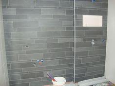 Verwerkt Mosa stroken mix tegels van 5/10/15 cm hoog en 60cm breed. op de wand volgens patroon van MOSA. Met de verdeling is rekening houden met de douchekraan zodat deze in het midden van geplaatst wordt. Flooring, Bathroom, Home, Tile Floor, Home And Garden