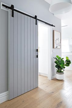 Rustic charm ✨ Barn doors are the answer to giving your home a subtle feature and a point of difference. Find what you need to get started! #bunnings #bunningsmag #barnstyle #barndoors #woodendoordesign #bedroomdoorpainting