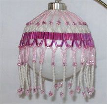 Pink belted Victorian Christmas ornament (several ornaments available; various prices)