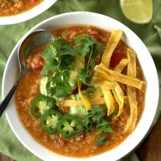 This hearty vegan taco soup is made with Mexican spiced red lentils, and topped with rich avocado crema and crispy tortilla strips.