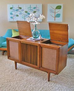 """This is a vintage 1961-62 Danish Mid Century Modern cabinet (designed by Kip Stewart for Drexel's """"Declaration"""" line of fine furniture,) in excellent condition. Inside this beautiful cabinet is a Motorola 3-channel, 7 speaker console stereo"""